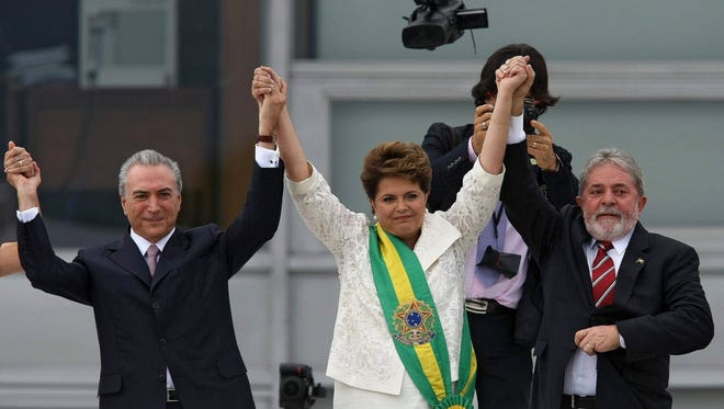 Michel Temer, left, with Brazilian President Dilma Rousseff, center, seen here in 2011.
