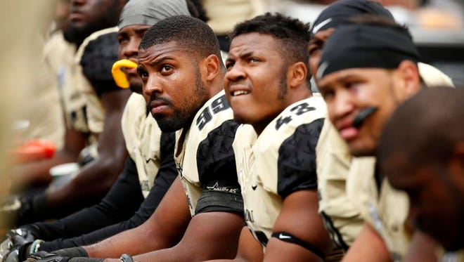 Vanderbilt Commodores linebacker Landon Stokes (99) and teammates watch from the sideline during the fourth quarter of their game against the Georgia Tech Yellow Jackets at Bobby Dodd Stadium. The Yellow Jackets won 38-7.