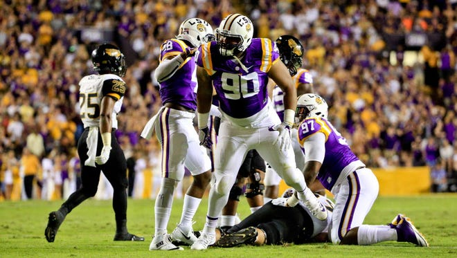 LSU Tigers defensive tackle Rashard Lawrence (90) celebrates after a defensive stop against Southern Miss during the first half.