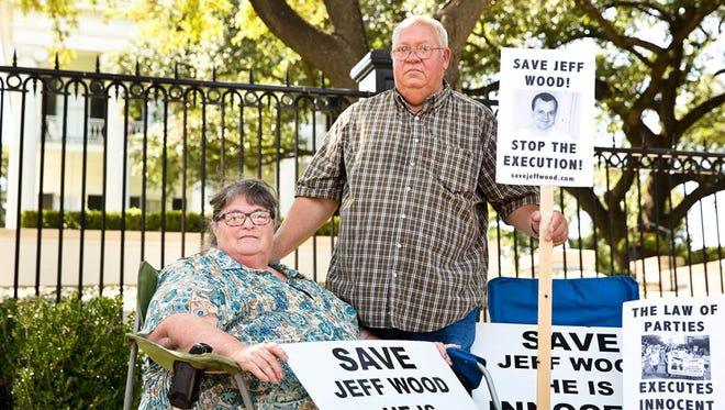 Mitzie and Danny Wood, parents of Jeff Wood, at a rally in July 2016 at the Governor's mansion. Their son, Jeff, was sent to death row under the controversial law of parties statute.