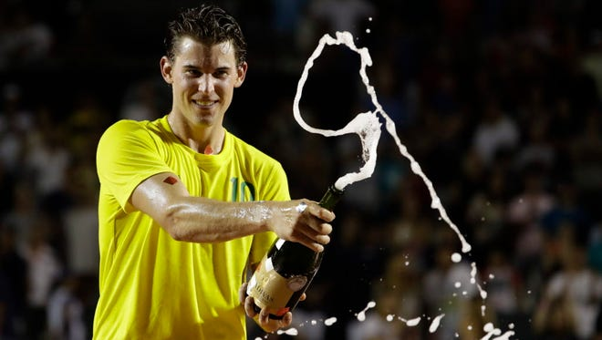 Dominic Thiem celebrates his victory over Pablo Carreno Busta in the final of the Rio Open.