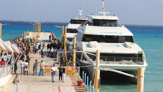 Mexican federal police officers and army soldiers arrive at the dock where an explosion occurred on a ferry in Playa del Carmen on Feb. 21, 2018.