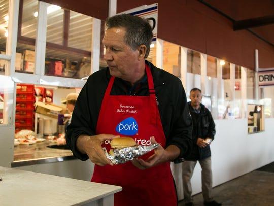 Republican presidential hopeful John Kasich prepares