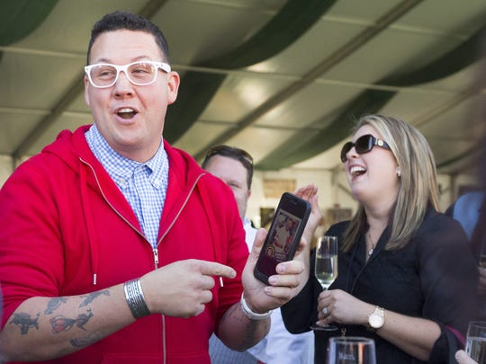 Chef Graham Elliot socializes with guests at the during the Azcentral Food & Wine Experience in Scottsdale on November 7, 2015.