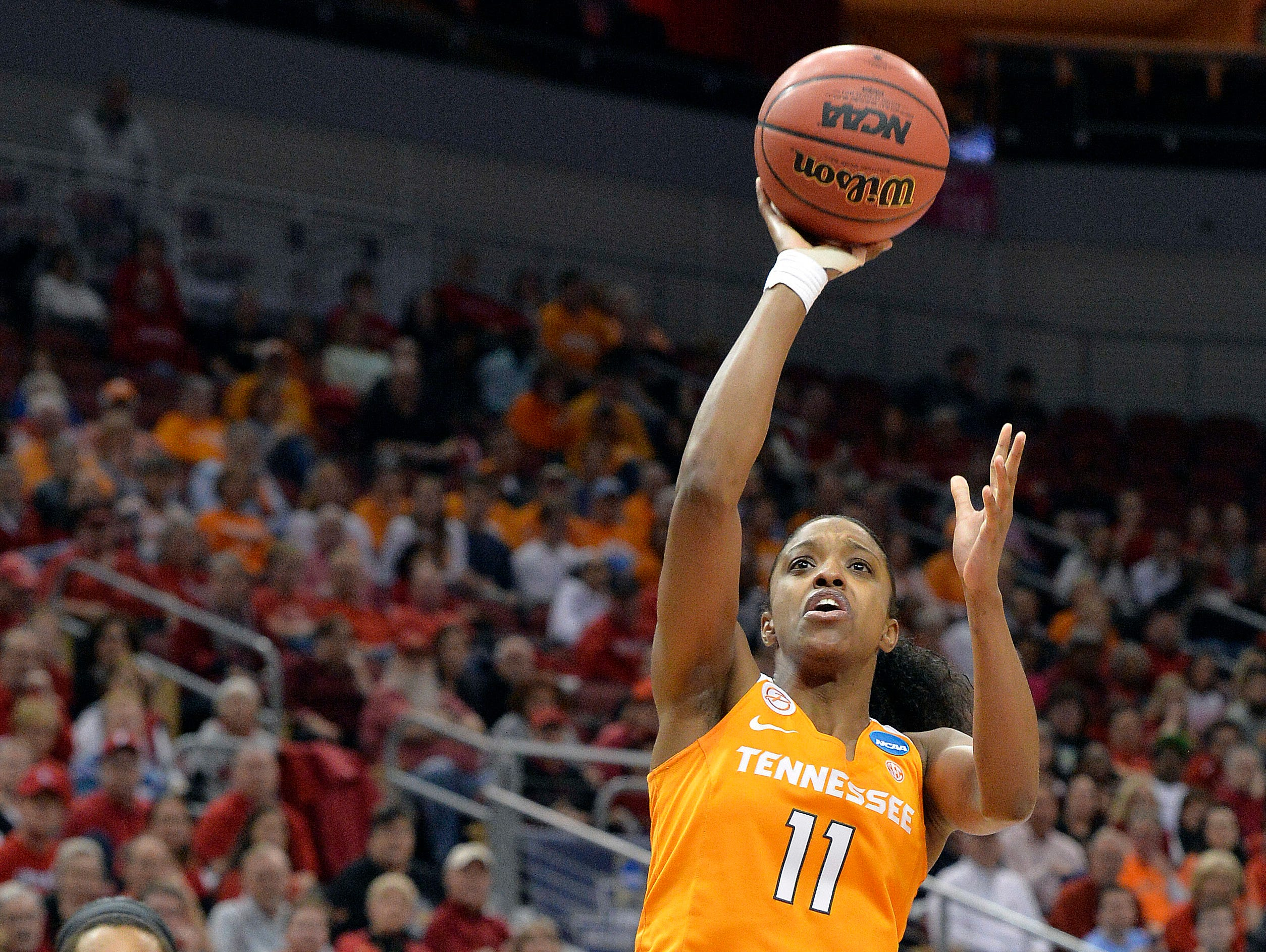 Tennessee's Diamond DeShields charges into Louisville's Myisha Hines-Allen during the first half of Monday's second-round NCAA tournament women's college basketball game in Louisville, Ky.
