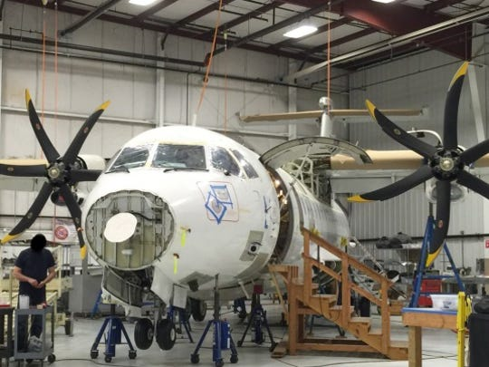 This photo provided by the Justice Department, taken in April 2015, shows a Drug Enforcement Agency ATR 42-500 at the Defense Department's subcontractor's facility. The plane is stored in Delaware.  The Justice Department inspector general issued a scathing audit Wednesday.