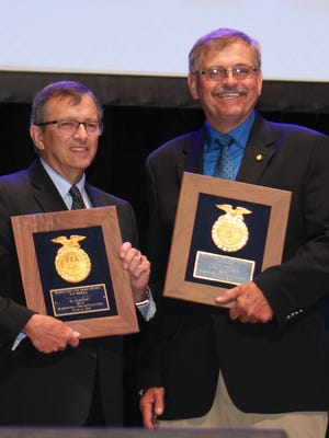 Al Herrman (left) and David Laatsch were  honored with the VIP Award during the 88th Wisconsin FFA Convention Wednesday, June 14, 2017.