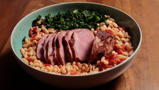 Stehlins's meat shop cottage ham, prepared with greens and white beans, pictured, Monday, Nov. 7, 2016.