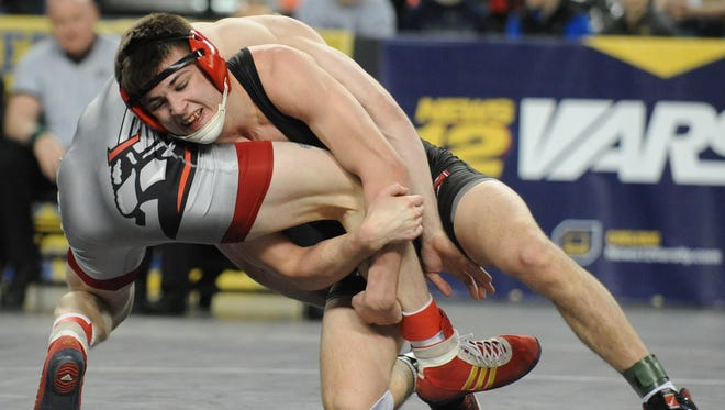 Kingsway's Trace Kinner attempts to take down Bound Brook's Robert Cleary in a 138-pound consolation bout at the state wrestling tournament in March. Kinner committed to wrestle at NC State on Friday.