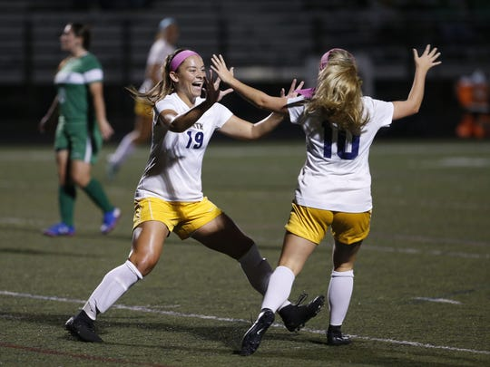 Marisa Tava (19) of Toms River North celebrates with Maddy Bennett after scoring a goal against Brick during girls high school soccer game at Toms River North High School,Toms River,NJ. Monday, October 9, 2017. Noah K. Murray-Correspondent Asbury Park Press