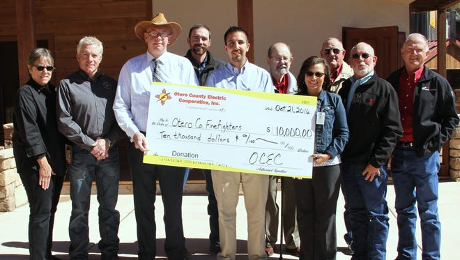 Otero County Electric Cooperative and CoBank donated $10,000 to the Otero County Volunteer Firefighters Association Oct. 21.