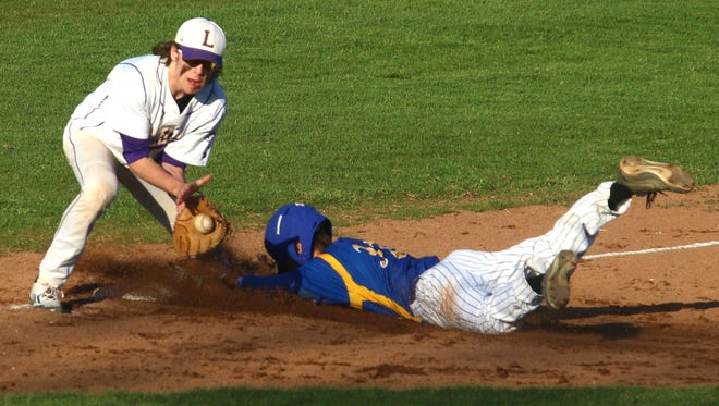 Wooster's Nate Steiner slides into third base against Lexington's Hunter Biddle at Lexington High School on Tuesday.