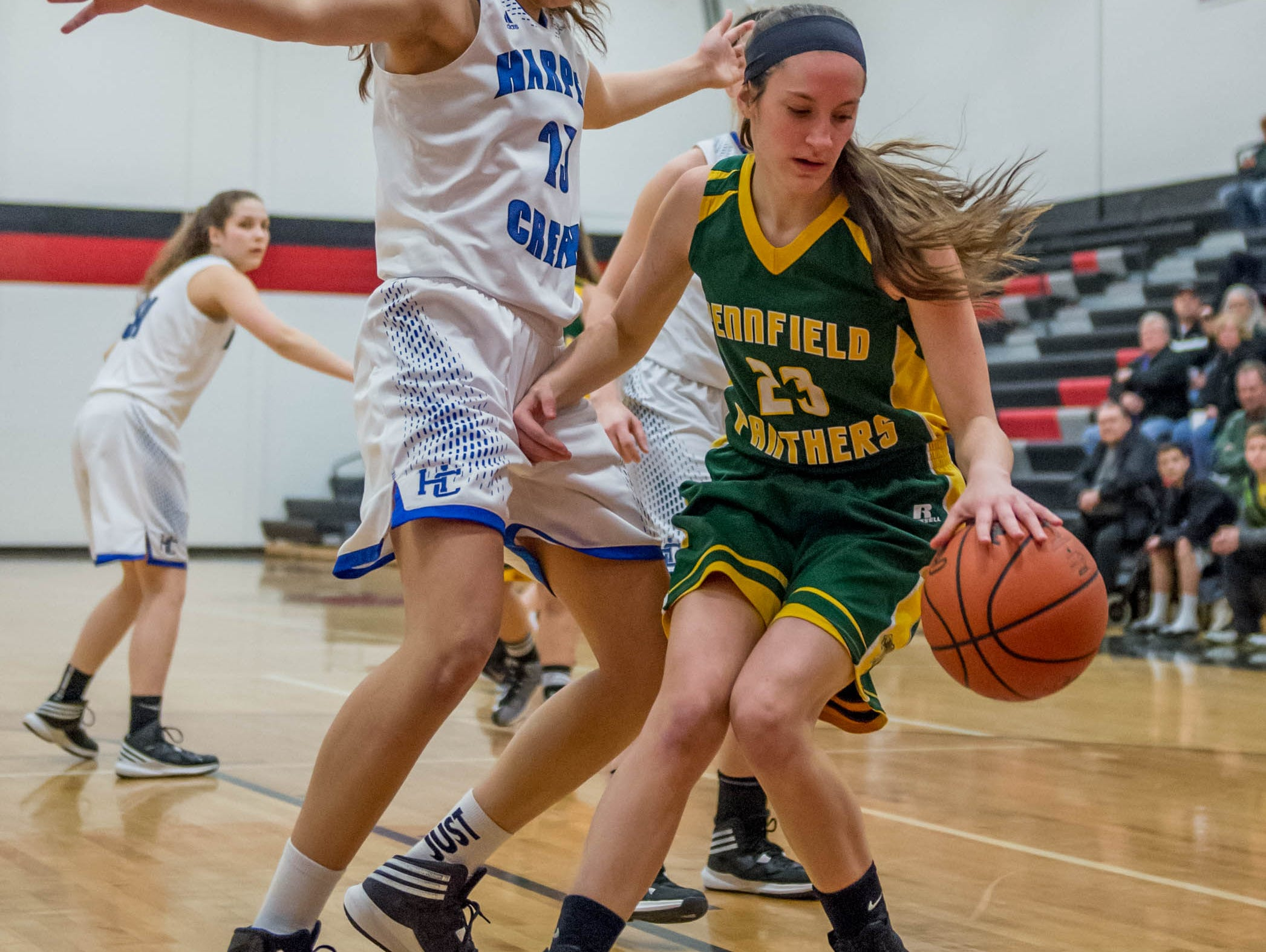Harper Creek's Charley Andrews (23) guards Pennfield's Brianna Abercrombie (23) in first round of districts game at Marshall Monday evening.