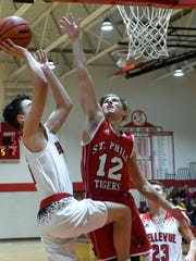 Bellevue's Gino Costello (3) tries for two points as St. Philip's Jack Gallagher (12) tries for the block.