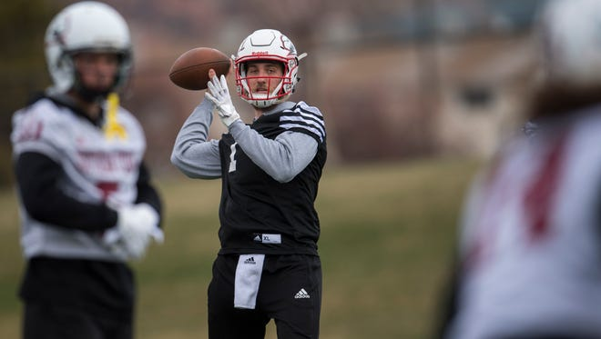 Quarterback Aaron Zwahlen throws the ball during the Southern Utah University's first Spring football practice at Eccles Coliseum Wednesday, March 21, 2018.