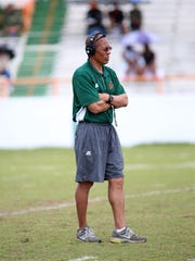 First-year Florida A&M coach Alex Wood watches the Orange and Green game from the field.