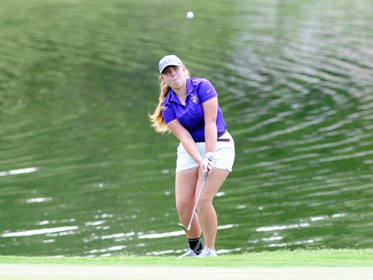 Wylie's Andrea Davis shoots onto the green during the first round of the UIL Class 4A state tournament. Davis shot a first-round 91.