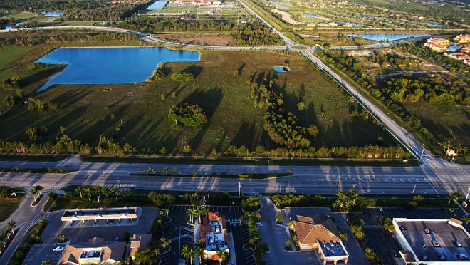 This is a file photo of the North Point Property on the northeast corner of Williams Road and U.S. 41 in Estero. Estero leaders would like it to become a town center, but the North Point owners aren't making decisions yet. On the right is the Hertz world headquarters, which is being developed.