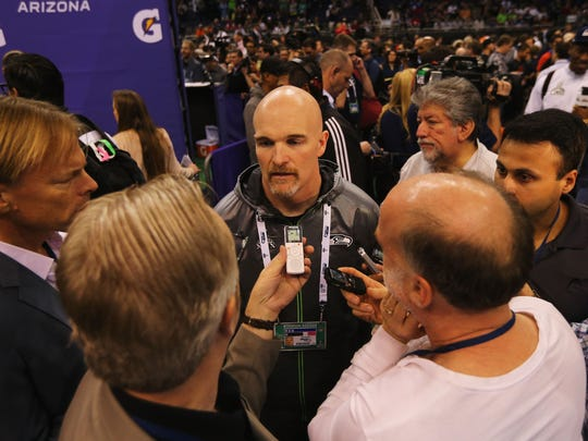 PHOENIX, AZ - JANUARY 27: Defensive coordinator Dan Quinn of the Seattle Seahawks addresses the media at Super Bowl XLIX Media Day Fueled by Gatorade inside U.S. Airways Center on January 27, 2015 in Phoenix, Arizona. (Photo by Elsa/Getty Images)