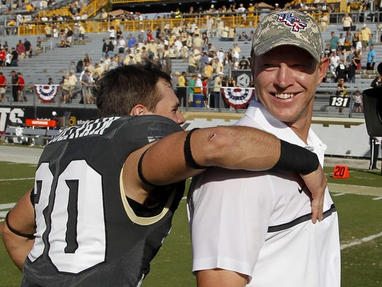 Nov 12, 2016; Orlando, FL, USA; UCF Knights head coach Scott Frost gets a hug from UCF Knights wide receiver Kyle Coltrain (30) after a football game against the Cincinnati Bearcats at Bright House Networks Stadium. UCF won 24-3 and with the win become bowl eligible. Mandatory Credit: Reinhold Matay-USA TODAY Sports