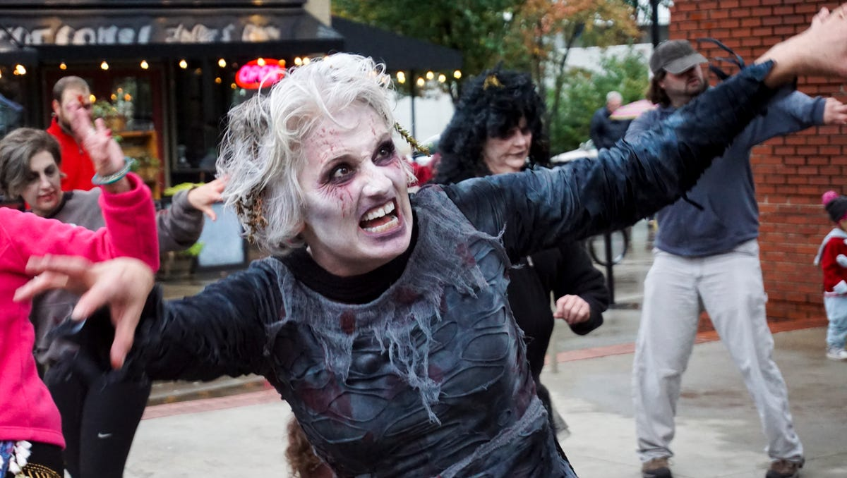 """Madeleine Reinke pauses during a rendition of Michael Jackson's """"Thriller"""" during the annual Knoxville Zombie Walk."""