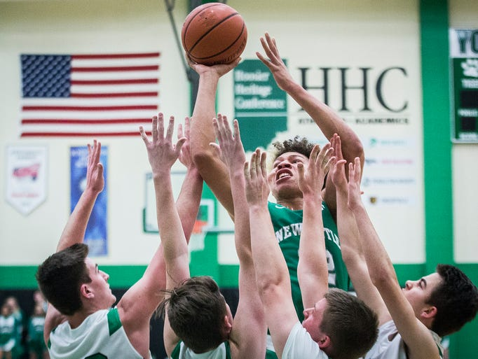 New Castle's Mason Gillis shoots past Yorktown's defense