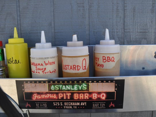 A tray near the order window at Jay's BBQ Shack features three homemade barbecue sauces. Owner Jay Stearns' original and ghost pepper barbecue sauces are available in individual servings with the plate orders.