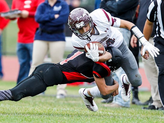 Newark Valley's Tyler Beebe trips up Sidney's Liam Matthews in the first quarter at Newark Valley on Saturday, October 14, 2017. Thomas La Barbera / Correspondent