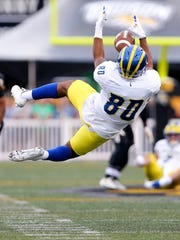 Delaware receiver Diante Cherry pulls in a pass in the first quarter at Johnny Unitas Stadium Saturday.
