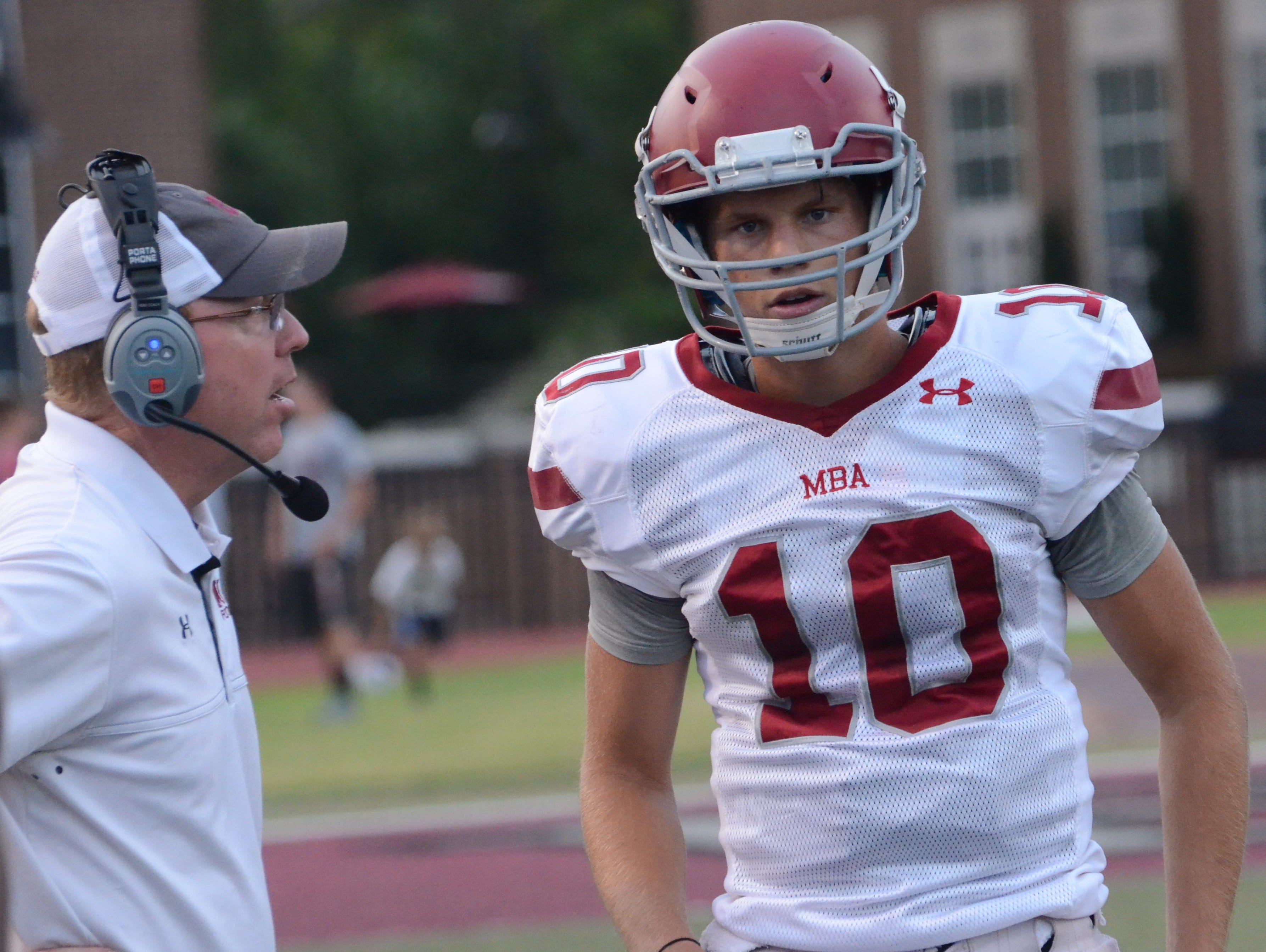 MBA quarterback Glenn Coleman get some words of advice from head coach Marty Euverard at a recent scrimmage.