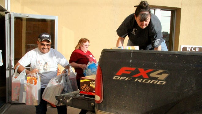 Packs for Hunger volunteers and Western Commerce Bank employees loaded the bank's donation into a truck on Tuesday.