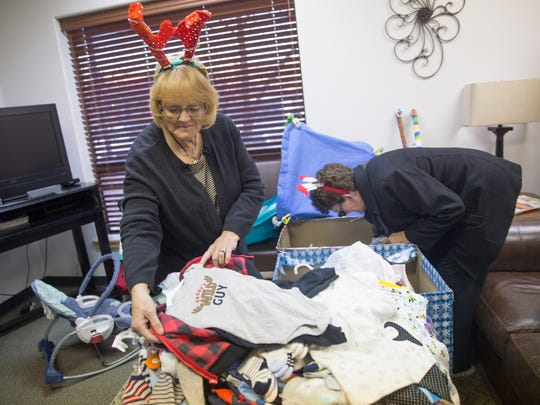 Patsy Clugston, left, and Kathy Robbins organize cloths, Friday, Dec. 15, 2017 at Grace Place Pregnancy and Health Center in Farmington.