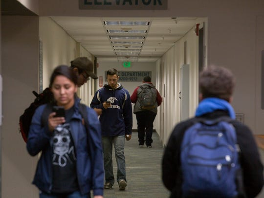 San Juan College students walk to class on Thursday on the college campus in Farmington.