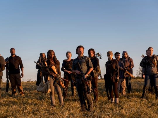 Rick (Andrew Lincoln), center, flanked by Michonne
