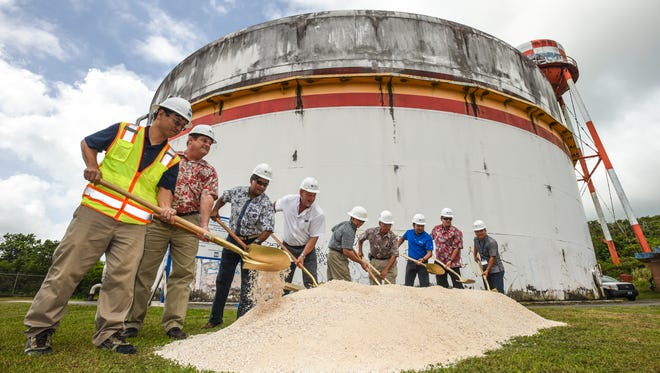 Guam Waterworks Authority officials, Consolidated Commission on Utilities members, project contractors and others take part in a ceremonial turning of the soil during a groundbreaking of a water tank replacement project in Yigo on Wednesday, Dec. 7, 2016. GWA plans to replace aging steel water tanks with new reinforced concrete tanks in Yigo and Astumbo to improve water service to relevant areas in northern Guam, according to the agency.