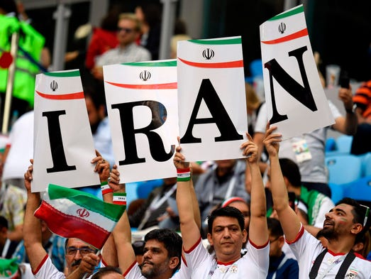 Iran fans cheer during the game against Morocco.