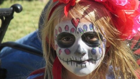 A young girl celebrates Dia de los Muertos in Lincoln.