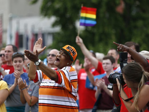 Corey Smith of Mt. Healthy, Ohio joined hundreds of others along with the group Why Marriage Matters Ohio at a rally for gay marriage in Lytle Park. Lawyers from four states ready to argue before an appellate panel weighing whether same-sex marriage bans are unconstitutional.