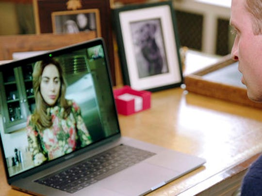 Screen grab image taken from recent undated video issued Tuesday April 18, 2017 by the Heads Together campaign of Britain's Prince William speaking to Lady Gaga via FaceTime. Prince William has brought Lady Gaga on board with in his efforts to persuade people to be more open about their mental health and crush the stigma associated with the issue. The heir to the throne released a video on Tuesday in which he speaks with the pop superstar in a FaceTime call from his home in London to her home in Los Angeles.