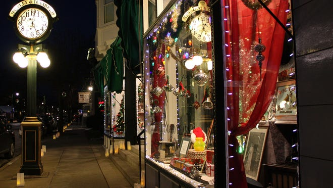 Paper lanterns line Washington Ave. in Cedarburg on Fridays during the holiday season. Many shops have holiday displays in their windows.