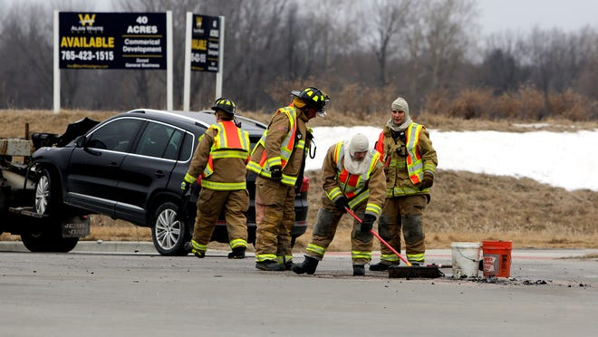Crews clear debris from the intersection of Cumberland Avenue and U.S. 231 in West Lafayette after a small SUV and a Lafayette Limo shuttle collided Tuesday, Feb. 17.