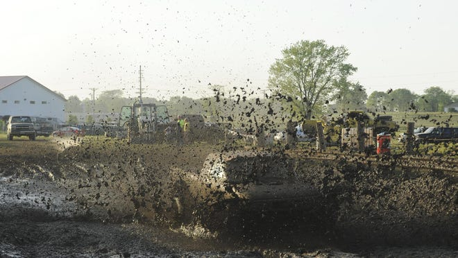 Cierra Andrews drives through the mud in her first truck May 24 at Awesome Acres Mud Bog in Carroll.