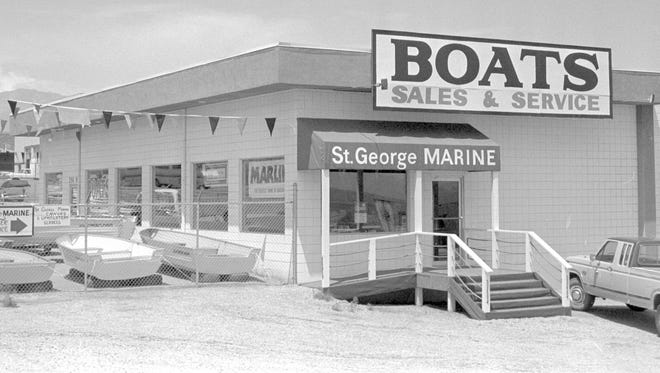 """In June of 1988, Spectrum photographer Nancy Rhodes captured the then image showing what was at the time, St. George Marine. Winlectic, a local company that sells wholesale electrical parts, was actually in the same building at the time but was only occupying the back half of the large one story structure.Winlectric had moved into the building when the company was founded in1985. St. George Marine moved out of the building in 1996 and Winlectric expanded to take over the front of the building in about 2000 according to Dan Abbott, who took over the business from Scott Hansen, the original owner, in 2000. Abbott indicated the building started life as a turkey processing plant and was built in the early part of the 20th century. In fact, a copy of the 1961 Dixie Roundup Rodeo program shows an image of what appears to be the same building with a sign for Bill's Best atop the structure in an advertisement for Barlocker Farms, """"the world's largest producer of hy-brid turkeys."""" William """"Bill"""" Barlocker, who owned Barlocker Farms and the Bill's Best turkey processing plant served three terms as mayor of the City of St. George in the 1950s and 60s."""