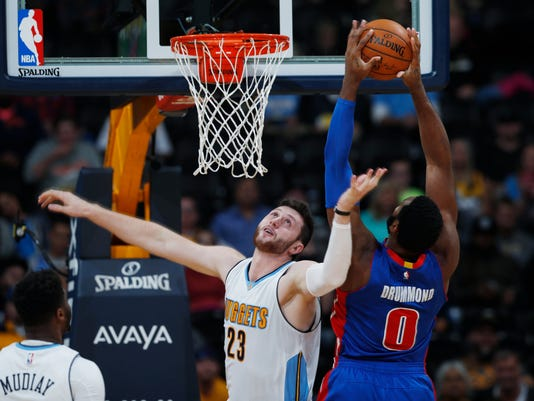 FILE - In this Nov. 12, 2016, file photo, Detroit Pistons center Andre Drummond, right, goes up for a basket over Denver Nuggets center Jusuf Nurkic, of Bosnia Herzegovina, in the second half of an NBA basketball game in Denver. A person with knowledge of the situation tells The Associated Press that the Denver Nuggets have traded Nurkic to the Portland Trail Blazers for center Mason Plumlee on Sunday, Feb. 12, 2017. (AP Photo/David Zalubowski, file)