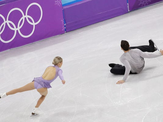 Chris Knierim of the USA falls while performing with partner Alexa Scimeca Knierim in the pairs free skate figure skating final in the Gangneung Ice Arena at the 2018 Winter Olympics in Gangneung, South Korea, Thursday, Feb. 15, 2018. (AP Photo/David J. Phillip)