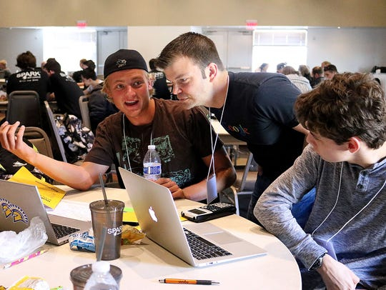 Students at the 2016 SPARK Game Jam work on their game