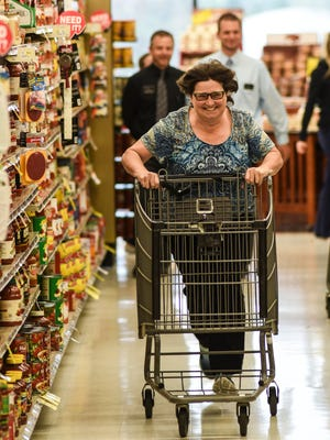 Pam Wunderlich of North Cornwall Township sprints down the second aisle during her 30 second shopping spree at Musser's Market on Friday, April 22, 2016. Wunderlich grabbed $297.93 worth of meat during her shopping spree.