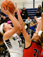 West York's Catie McCarty, left, takes the ball to