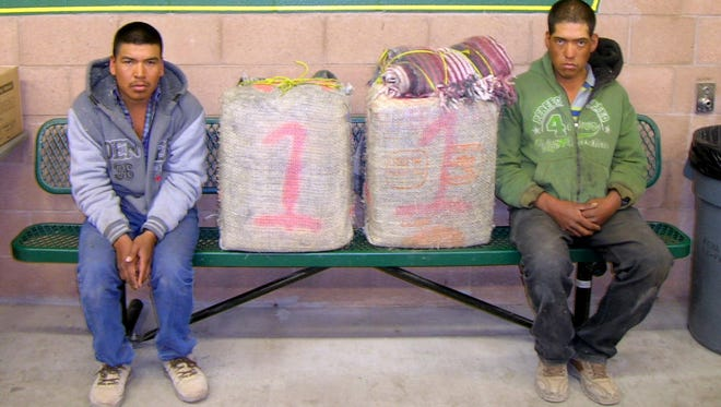 Two Mexican Nationals, from left, Guadalupe Renteria Moreno, 24, and Ricardo Palma Palma, 29, were part of an early Monday morning seizure that uncovered over a quarter of a million in marijuana being smuggled in the boot heel region.