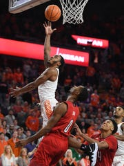 Clemson guard Marcquise Reed (2) scores over Louisville